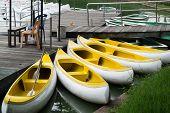 Yellow canoe mooring on the wooden port