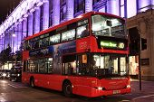 red double decker bus at night