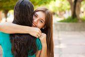 Happy Teen Hugging Her Friend