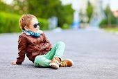 foto of bomber jacket  - stylish boy in leather jacket posing on the ground - JPG