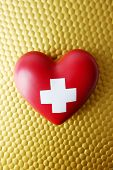 Red heart with cross sign on bright background