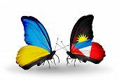 Two Butterflies With Flags On Wings As Symbol Of Relations Ukraine And Antigua And Barbuda