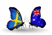stock photo of sweden flag  - Two butterflies with flags on wings as symbol of relations Sweden and Australia - JPG