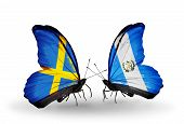 Two Butterflies With Flags On Wings As Symbol Of Relations Sweden And Guatemala