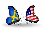 Two Butterflies With Flags On Wings As Symbol Of Relations Sweden And  Liberia