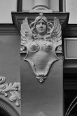 Bas-relief Of A Woman With Wings And A Star On The Wall Of An Old House