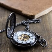 Pocket Watch Over Grunge Wooden Table