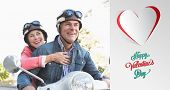 Happy senior couple riding a moped against cute valentines message