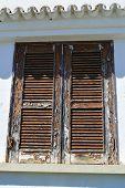 Old wooden window shutter in Portugal