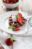 Belgian waffles with vanilla ice cream and strawberries