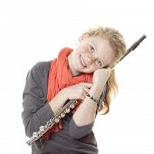 Young Girl With Red Hair And Freckles Holding Flute In Studio