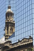 Reflection of the Cathedral of Santiago in modern windows, Chile.