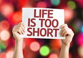 Life is Too Short card with colorful background with defocused lights