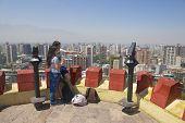 Young couple enjoy the view of Santiago, Santiago city, Chile.