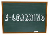 E-Learning words written or drawn on a chalkboard to illustrate web-based Internet or online education, learning and training