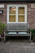 Bench And Window In Garden