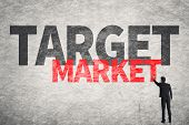 Asian business man write words on wall, Target Market