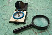 Map, Compass And Magnifying Glass