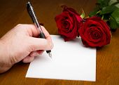 Hand Writing A Love Valentine Letter With Roses