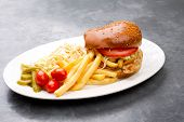chicken burger plate with french fries and salad