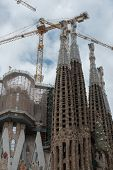 The Cranes Over Sagrada Familia Towers In Barcelona, Catalonia, Spain.