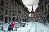 Bern, Switzerland - April 21, 2014: People On The Shopping Alley Kramgasse With The Famous Clock Tow