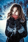 image of blowing  - Beautiful brunette girl blowing star dust  - JPG
