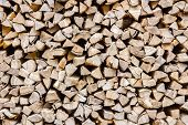 A Stack Of Birch Firewood - A Natural Horizontal Background, Close-up