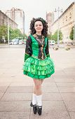 picture of wig  - Young woman in irish dance dress and wig posing outdoor - JPG