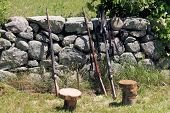 stock photo of stonewalled  - Three rifle muskets leaning against a stonewall at a Civil