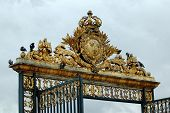 foto of versaille  - Gilded gate to the palace in Versailles - JPG