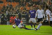 VALENCIA, SPAIN - JANUARY 4: Stuani shots for a goal during Spanish King Cup match between Valencia CF and RCD Espanyol at Mestalla Stadium on January 4, 2015 in Valencia, Spain