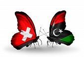 Two Butterflies With Flags On Wings As Symbol Of Relations Switzerland And  Libya