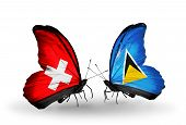 Two butterflies with flags on wings as symbol of relations Switzerland and Saint Lucia