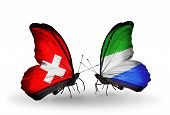 Two Butterflies With Flags On Wings As Symbol Of Relations Switzerland And Sierra Leone