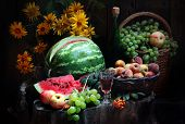 Wine, Peaches, Water-melon, Grapes. Apples And A Bouquet Of Yellow Camomiles