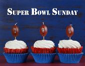 Red, White And Blue Theme Cupcakes With Football Toppers For Super Bowl Sunday Party Or Collage Foot