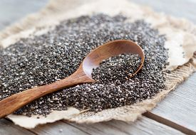 image of seed  - Chia seeds with a spoon close up