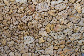 stock photo of pumice-stone  - porous pumice stones Wall texture close up - JPG