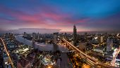 picture of modern building  - Bangkok Transportation at Dusk with Modern Business Building along the river  - JPG