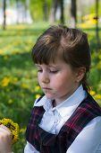 foto of dandelion  - thoughtful little girl close - JPG