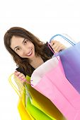 picture of excite  - Happy and excited shopping woman looking to her shopping bags - JPG