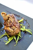 foto of leek  - Piece of Lamb leeks and sauce on a plate - JPG