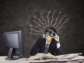 picture of gas mask  - Thougtful Businessman wearing gas mask with arrows on blackboard - JPG