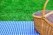 foto of blue  - Picnic Basket On The Table With Blue White Checkered Tablecloth - JPG