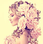 image of flower girl  - Beauty girl with rose flowers hairstyle isolated on white background - JPG