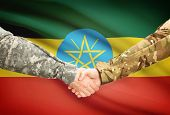 picture of ethiopia  - Soldiers shaking hands with flag on background  - JPG