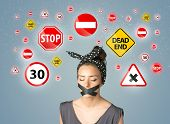 pic of taboo  - Young woman with taped mouth and traffic signals around her head - JPG