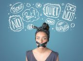 picture of taboo  - Young woman with taped mouth and white drawn thought clouds around her head  - JPG