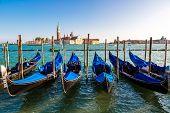 foto of gondola  - Gondolas in a summer day in Venice Italy - JPG